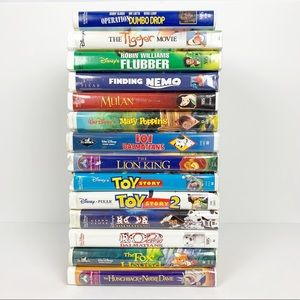 14 Vintage Disney VHS clamshell tapes
